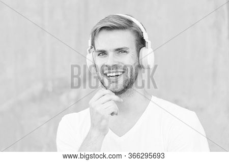 Headphones Suitable For Head Size. Happy Guy Wear Headphones Grey Background. Handsome Man Smile Wit
