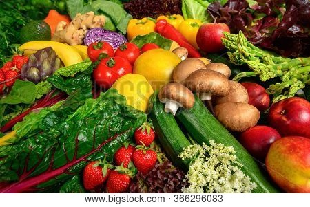 Arrangement Of Fruits And Vegetables In Many Appetizing Colors, Inviting To Lead A Healthy Plant-bas