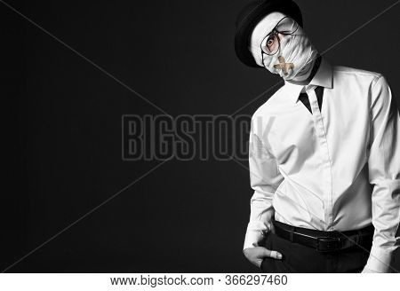 Strange, Injured Man In White Shirt And Black Pants, Wearing Stylish Hat And Glasses. His Head Wrapp