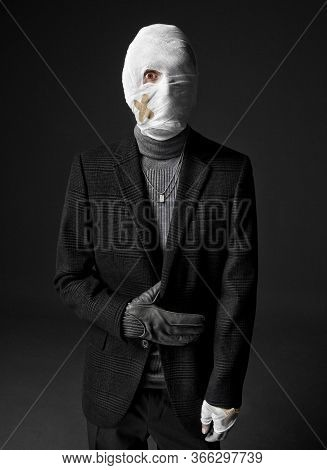 Strange Looking Injured Man In Black Turtleneck Sweater And Suit, His Head Wrapped Up With Bandages.