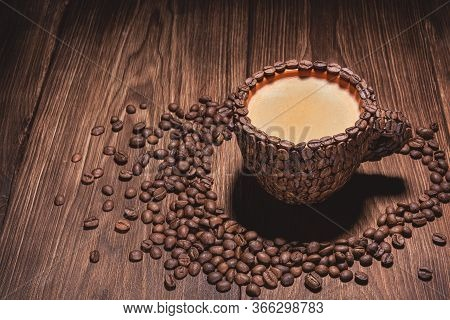 Coffee Cup With Coffee Made From Coffee Beans Wooden Table. Natural Coffee Beans Arabica. Coffee Cup