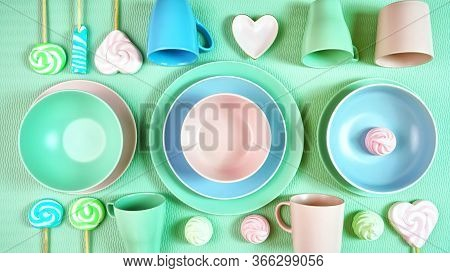 Modern Pastel Pink, Green And Blue Ceramic Tableware On Pale Green.