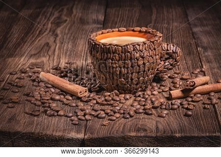 Natural Coffee Beans Arabica Close-up Macro. Coffee Cup Table Wood Grain Coffee Side View Cinnamon S