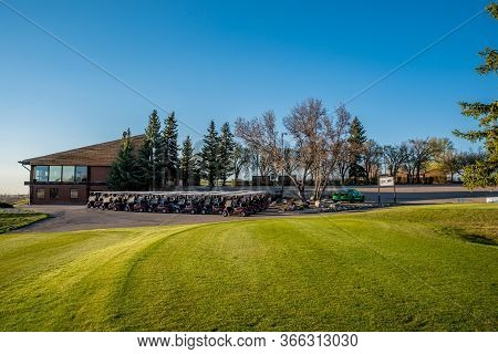 Swift Current, Sk/canada- May 14, 2020: Sunset Over The First Tee, Carts And Clubhouse At Elmwood Go