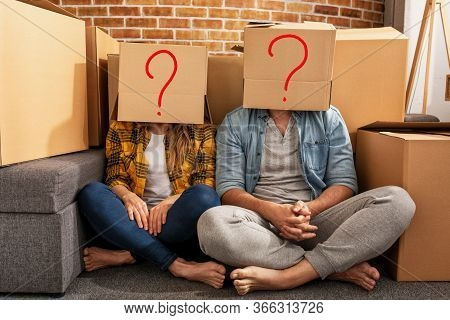Confused Couple Of Having To Move And Arrange All The Packages. Concept Of Success, Confusion, Chang