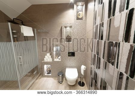 Dressing Room In Beige Colors. In The Frame Is A Shower, Toilet, Toilet Paper, Towel. The Wall Is De