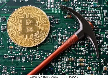 Bitcoin And Pickaxe On Background Of Micro Schemes, Cryptocurrency Concept