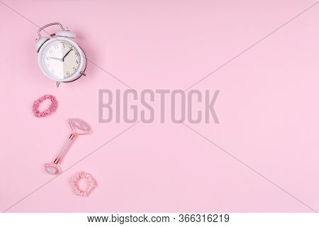Jade Face Roller With White Clock And Pink Accessories. Beauty Time, Selfcare And Beauty Accessories