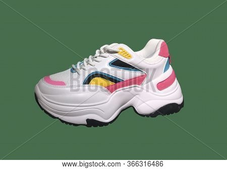 White Platform Sneakers With Bright Color Accents Pattern On Green Background. Close View Of Fashion