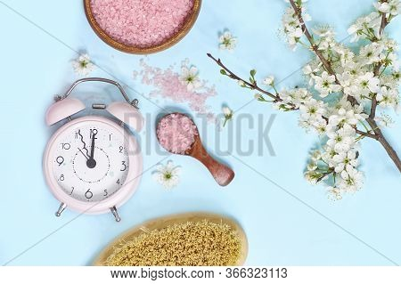 Spa Setting Spring Flowers With Towel , Salt In Bowl, Spring Time Change, Spring Flowers And Alarm C