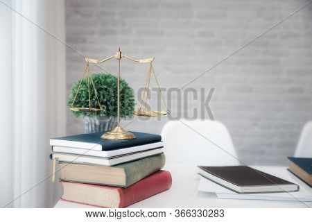 Gold Brass Balance Scale On Books In Lawyer's Office. Symbol Of Law And Justice.