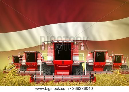 Many Red Farming Combine Harvesters On Grain Field With Latvia Flag Background - Front View, Stop St
