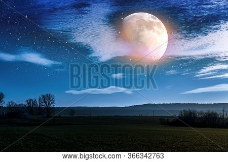 The Cloud Landscape Of The Countryside. Night Sky And Bright Moon.