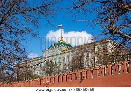 Moscow, Russia, May 2020. The Grand Kremlin Palace Behind The Kremlin Wall. The Developing Flag Of R