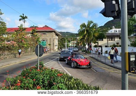 Victoria, Seychelles - July 8, 2011: Street Scene In Victoria, Car Traffic On A Cross Road. Victoria