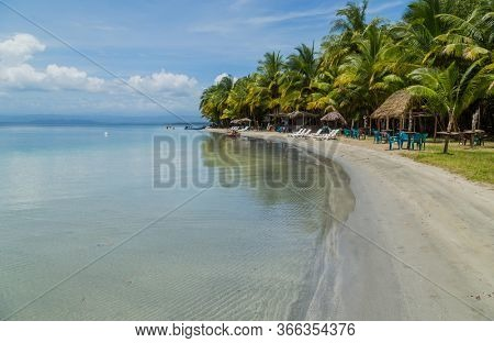 Bocas Del Toro, Panama: August 23, 2019: beautiful caribbean beach with chairs, Bocas del Toro, Panama