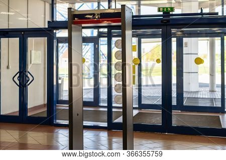 Arch Of Metal Detectors. Security. Walk Through Detector. Checking People At The Entrance To The Bui