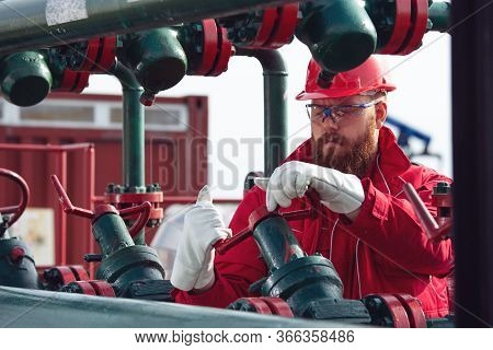 Oil And Gas Industry Worker. Engineer Working On Pipeline Equipment For Oil And Gas Company.
