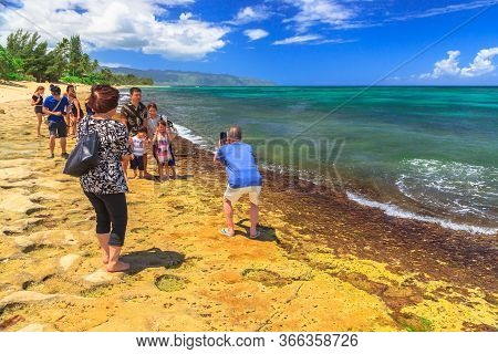 Oahu Island, Hawaii, United States - August 26, 2016: Tourists Taking Selfie Pictures With Green Sea