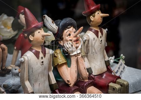 Siena, Italy, April 2018: Wooden Statue Of Pinocchio With Donkey Ears And Long Nose. Pinocchio Is Th