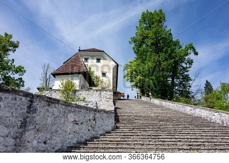 Staircase And The Historical Buildings On The Island In The Middle Of Bled Lake In Slovenia