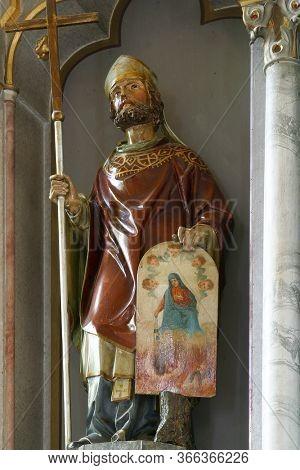 KAMANJE, CROATIA - JULY 02, 2016: Saint Cyril, statue on the main altar in the parish Church of the Holy Name of Mary in Kamanje, Croatia