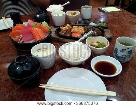 Japanese Food Set On The Table, Sashimi And Seafood Teppanyaki