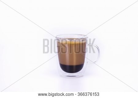 View Of A Glass Cup With A Capuccino
