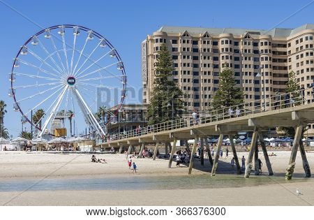 Adelaide, Australia - March 8th, 2020:a Ferris Wheel Near The Wharf On The Beach Of Adelaide, Austra