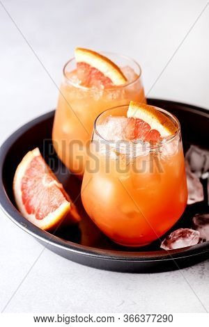Glasses Of Cold And Tasty Pink Grapefruit Juice Decorated With Slice Of Ripe Grapefruit Cold Juice O