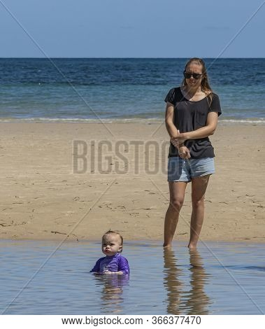 Adelaide, Australia - March 8th, 2020: A Young Mother And Her Baby On The Beach At Adelaide, Austral