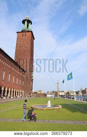 Stockholm, Sweden - August 23, 2018: People Visit Park In Front Of Stadshuset (city Hall) In Stockho