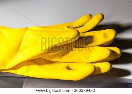 Yellow Rubber Gloves For Safe Cleaning, Protection Of The Hands While Performing Tasks Involving Che