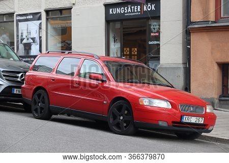 Stockholm, Sweden - August 24, 2018: Red Volvo V70 Station Wagon Parked In Stockholm, Sweden. There