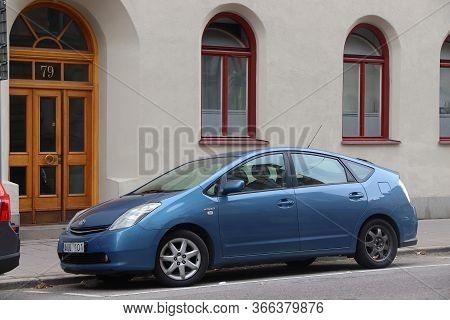 Stockholm, Sweden - August 24, 2018: Blue Toyota Prius Hybrid Compact Car Parked In Stockholm, Swede