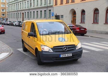 Stockholm, Sweden - August 23, 2018: Postman Van In Stockholm, Sweden. Postnord Is The Merged Postal