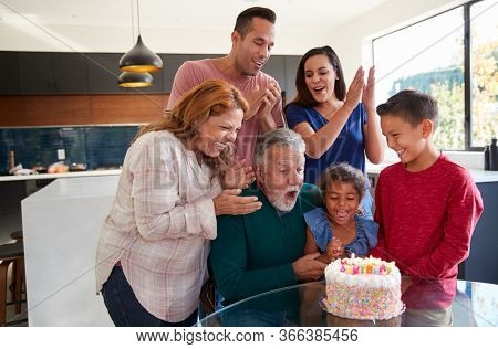 Multi-Generation Hispanic Family Celebrating Granddaughters Birthday At Home Together