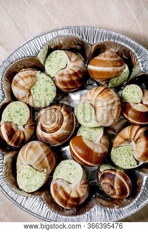 Frozen Uncooked Escargots De Bourgogne - Snails With Herbs Butter, Gourmet Dish, In Store Aluminum P