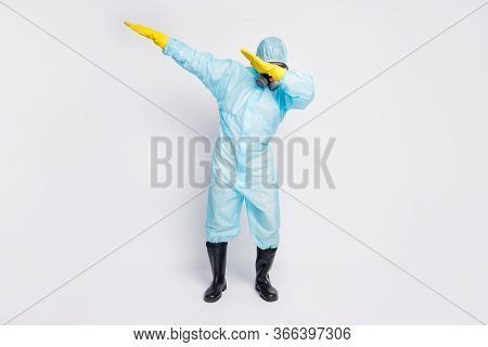 Full Length Photo Of Dabber Man Dance Close Cover Face Hands Wear White Biohazard Uniform Breathing