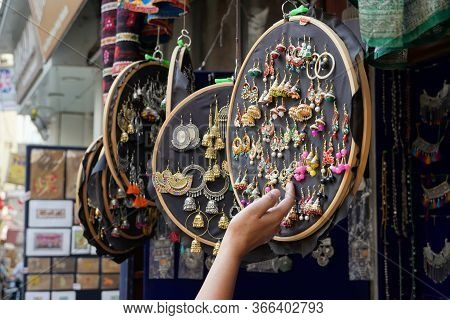 Colorful Handmade Earrings Hanging For Sale For Tourists At The Street Market In Udaipur India. Colo