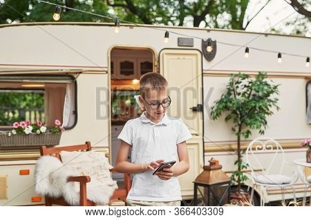 Child Boy Near House On Wheels. Family Vacation Travel Rv,holiday Trip In Motorhome.caravan Car Vaca