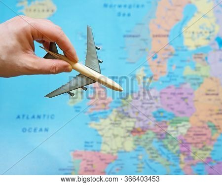 Toy Plane And Europe Map On The Background.