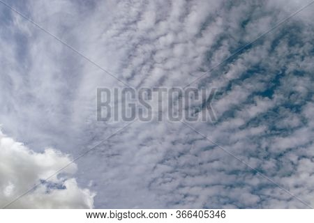 A Few Light Feathery Clouds In A Clear Blue Sky. Summer Bright Image Of The Sky.