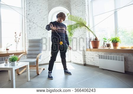 Portrait Of Millenial Boy Using Retro Toys, Meeting Things From The Past And Having Fun. Generation