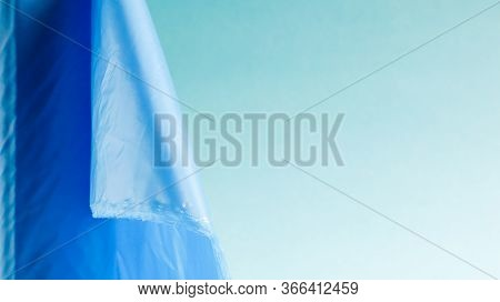 One Roll Of Plastic Trash Bags In Blue On A Blue Background. Bags That Are Designed To Accommodate G