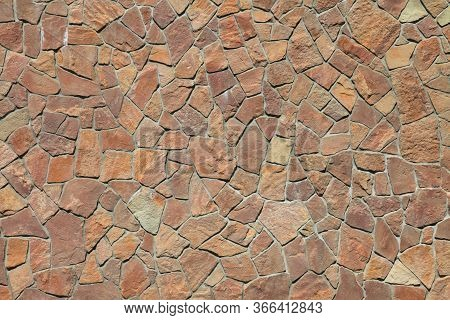 Granite Stone Wall, Background. Mosaic Structure Of Surface, Made Of Granite Rocks (bricks). The Wal
