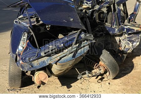 The Car Crash On The Road. Passenger Car Is Completely Broken. Fatal Traffic Accident. A Car Destroy