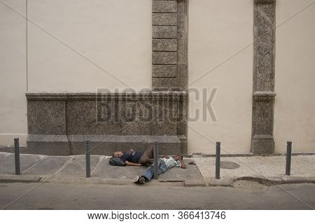 Rio De Janeiro, Brazil - March 19, 2016: Homeless Drunkers Sleeping In The Streets Of Candelaria, In