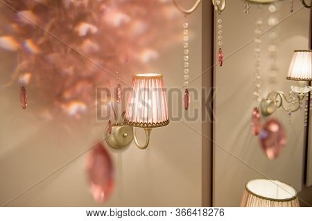 Wall Lamp With Pink Lampshade Attached To The Wall