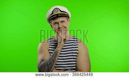 Young Muscular Sailor Man Thinking And Looking At Camera. Seaman Guy Smiling In Sailors Vest. Stripe